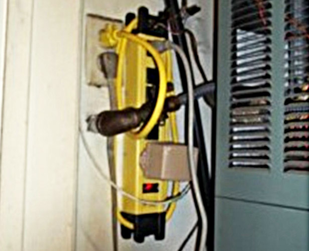 Electrical Safety - Overloaded Powerboard Wedged Behind Plumbing